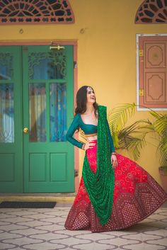red and green bridal lehenga, green dupatta, glittery dupatta, full sleeves blouse
