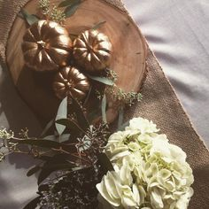 Rounding out our festive tablescape with golden pumpkins,  burlap, wood and soft…