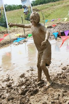 Got mud?  This young man is covered in mud as he nears the finish line of the first annual SPLAT! Jr. Obstacle Mud Course Run in Columbia, MO.