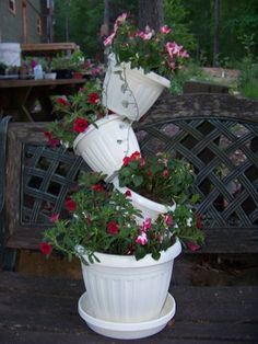 This is called a tipsy pot project. Can be done with clay, galvanized steel, or plastic containers. Also hanging or in the ground.