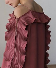 The Calin Top in Pink, featuring thin straps, square neckline, dimple sleeves in ruffle detailing with self-tie. COMPOSITION AND CARE Dry clean only Please treat with care to extend the life Sleeve Designs, Blouse Designs, Fashion Details, Fashion Design, Mode Style, Fashion Show, Fashion Trends, Designer Dresses, Designer Clothing
