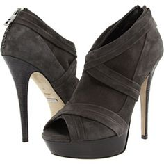 Stacked wooden platform and stiletto heel engraved with subtle check.  Can I please have these?????