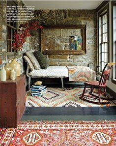 love this outdoor room, bed, blanket, rug, jug assortment, delicious empty frame on stone wall. . . rocking chair