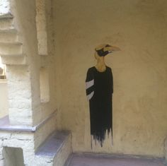 A stunning piece of street art tucked away in Hauz Khas. The cream wall was the perfect canvas.