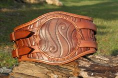 A male hero belt this time, custom make. Boar design on the front boss by myself, along with the intertwined boars. The left and right facing boars are from a pictish design of a boar. Hero belts t...