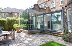 A contemporary open plan extension with a structurally glazed picture frame corner window and sliding aluminium doors Corner Windows, Aluminium Doors, House Extensions, Modern Glass, Open Plan, Mudroom, Picture Frames, Laundry, Houses