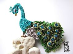 Vendula Maderska of Magic With Hook and Needles captured the beauty and bold colors of a peacock in this crochet and beaded brooch.