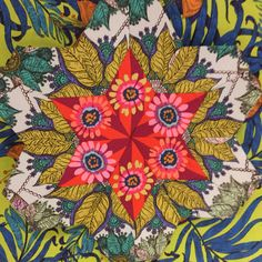 Studio KM meets Kaffe Fassett in this fussy-cut block. The block is Marg George's new star design - a hexagon interrupted. Posted at Material Obsession.