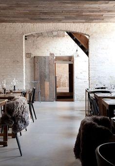 Like: textured walls, brick archway, barn doors, ceiling