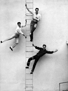 (L to R) Tony Curtis, Rock Hudson, and Robert Wagner, smiling, while posing on ladder together. (Photo by Sharland//Time Life Pictures/Getty Images) 1954