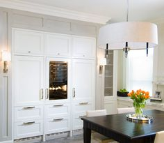 .: O'Brien Harris : crisp and clean   attention to detail evidenced in colour, lighting fixtures and furnishings   silver brings both modern and classic vibe to this kitchen