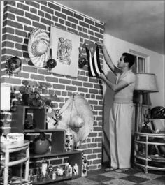 Desi Arnaz adding some finishing touches inside his and Lucy's home in Chatsworth, CA.