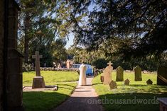 Vicar in white robes stands in church graveyard waiting for the arrival of the bride. Documentary wedding photograph by one thousand words Church Wedding Ceremony, Vicars, One Thousand, Documentary, Waiting, Photograph, Bride, Gowns, Photography
