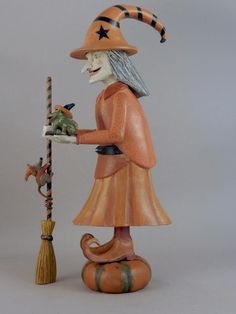The 'Pumpkin Witch' is my latest witch commission. She is a smaller version of a full-sized Pumpkin Witch I made several years ago. She is accompanied by her 'familiars' which are a bullfrog and a mouse. Carved from Maine white cedar. Kicking Bull Gallery Folk Art & Paintings - Jay Miles - www.facebook.com/kickingbullgallery?ref=hl