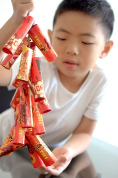 Chinese new year 2/10/13. craft....fire crackers made from red packets...  #FengShui #ChineseNewYear http://patricialee.me