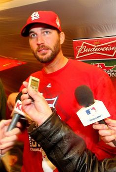 Adam Wainwright talks to media in the clubhouse- NLCS champions  10-18-13