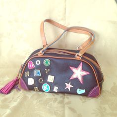 Dooney & Bourke Charm Bag! ADORABLE black D&B charms bag with rainbow zipper! Interior shows wear as shown, but exterior (aside from scuff on top) in GREAT condition!!! This bag is no longer made! Dooney & Bourke Bags