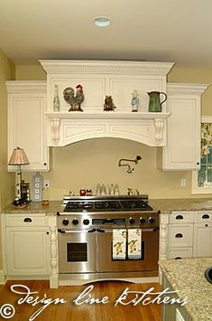 I like the shelf on the range hood. - my dream kitchen.  Want one professional stove such as this for Dean :)