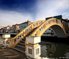 Ponte de Carcavelos - Aveiro, Portugal, located over the Canal de São Roque dating from built to replace the original bridge, which collapsed in Places In Portugal, Visit Portugal, Portugal Travel, Portugal Trip, Learn Brazilian Portuguese, Portuguese Culture, Exotic Places, Douro, Covered Bridges