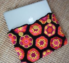 crochet laptop cover -- ewww pattern, but like buttons (want to be sure it'll hold)