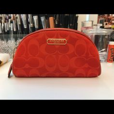 Coach Makeup Bag Color: Red. From the holiday collaboration with Estee Lauder. Coach Accessories