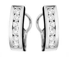 9684. 18k white gold earrings with brilliant cut diamonds. $2115