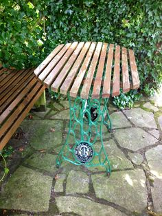 Garden table made from an old Singer sewing machine base.