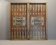 """A Backgammon board. As mentioned in Chapter One: """"The olive-wood board was intricately inlaid with ebony, ivory and mother of pearl. Chess Squares, Backgammon Game, Wood Hinges, Wooden Projects, Diy Games, Game Pieces, Board Games, Game Boards, Luke"""