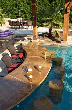 Enjoy guests' company even if they don't want to swim as you sip delicious drinks from both sides of this stylish poolside bar.