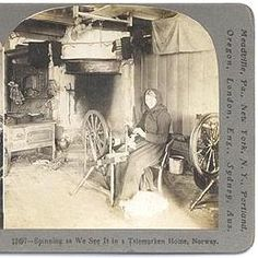 This 1906 stereoscope photo was to be viewed thru a view finder for 3D affect.  The Telemark  Norway kitchen features a large corner fireplace, cookstove and two spinning wheels, with drying rack hung overhead.
