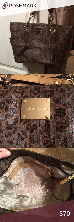 Calvin Klein large purse Only used a few times  Calvin Klein monogram purse. Similar to Michael Kors. Calvin Klein Bags