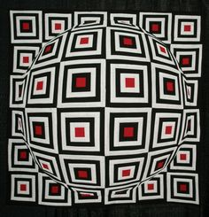 Spectacular quilt show! Optical illusion quilts (like the one pictured) and rainbow quilts!