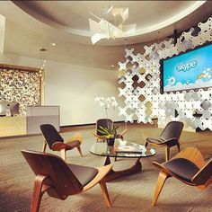 8. Great textured wall. Warm, modern lobby of @Skype offices in #Stockholm featuring white #Foscarini #Bigbang Suspension Light.