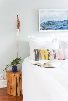 Just one piece of sea-inspired art makes this bedroom feel beachy, but in a way that doesn't feel out of place in this NYC apartment, designed by Homepolish and featured on Rue Mag.