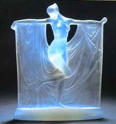 René Lalique 'Suzanne' a statuette, design 1929 frosted glass 22cm high, moulded and engraved 'R. Lalique'