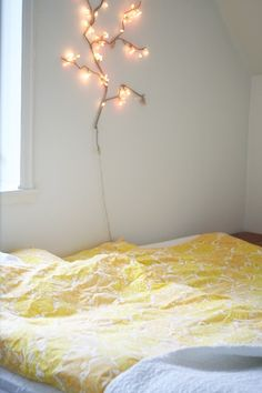 Home tour of Johanna Gartmyr. A real life Swedish home. Branch light fixture.