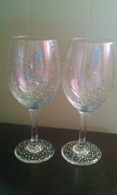 Wine glass, Colorful confetti painted wine glass. $10.00, via Etsy.