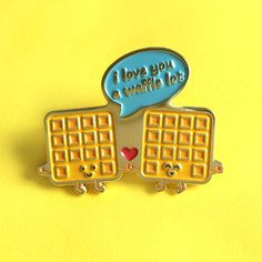 """i love you a waffle lot"" ENAMEL PIN  PRODUCT DESCRIPTION: • 1 1/4"" die struck soft enamel fill • Bright imitation gold plating • Butterfly clutch"