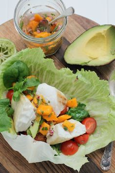 Fish tacos with mango and avocado salsa, wrapped in lettuce instead of a taco shells.