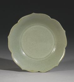 Exit Fullscreen    Reset Zoom      253  PROPERTY FROM A PRIVATE NORTH AMERICAN COLLECTION  A 'YUE' FOLIATE-RIM SMALL DISH  SONG DYNASTY  Estimation: 5,000 - 7,000 USD