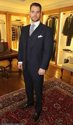 Dapper: Actor Henry Cavill, who has become friendly with Brooklyn's father David, looked very smart in a black suit