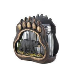 Add a little flavor to your food and a little deep woods style to your table! This glass salt and pepper shaker set sits neatly in a polyresin bear paw sculpture with a black bear inset.