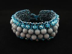 Pebbled River Bracelet by でれでれ DereDere Jewellery. Embellished net with Czech and Miyuki beads and Mashan Jade