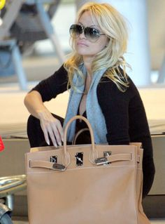 Pamela Anderson in Tom Ford sunglasses