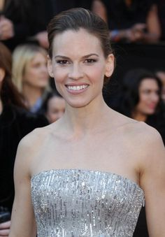 Hilary Swanks low, updo hairstyle