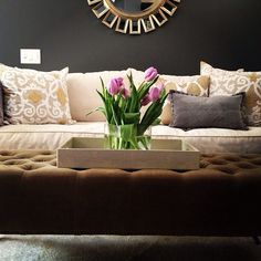 Stylists at  La Vie Est Belle Design rest tulips on our Largo Tray. Room is complete with Z Gallerie's Pauline Sofa, Gabriel Pillows, and Devon Mirror.