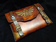 Leather Zelda tablet/iPad case by Skinz-N-Hydez pack equipment gear magic item | Create your own roleplaying game material w/ RPG Bard: www.rpgbard.com | Writing inspiration for Dungeons and Dragons DND D&D Pathfinder PFRPG Warhammer 40k Star Wars Shadowrun Call of Cthulhu Lord of the Rings LoTR + d20 fantasy science fiction scifi horror design | Not Trusty Sword art: click artwork for source