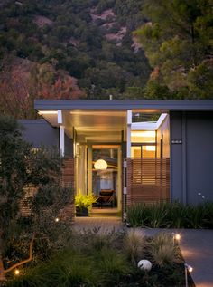 the front door of a renovated Eichler home in the early evening