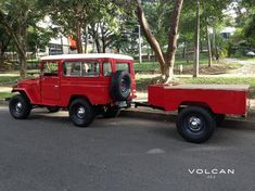 """Estella"" 1982 Toyota Land Cruiser FJ43 in Freeborn Red with custom matching adventure trailer from Volcan 4x4."