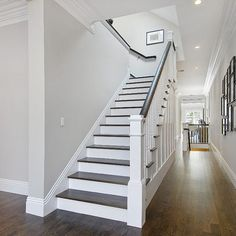 Stair Treatment- white with wood caps- open to carpet stairs too with mixed white and wood caps- stairs squeak right now which i don't link.